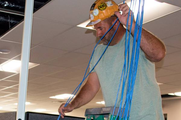Technician installing ethernet cable.