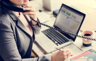Woman on business telephone.