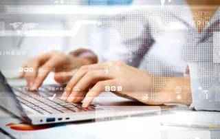 Woman's hands on keyboard. Connect to the worldwide web.